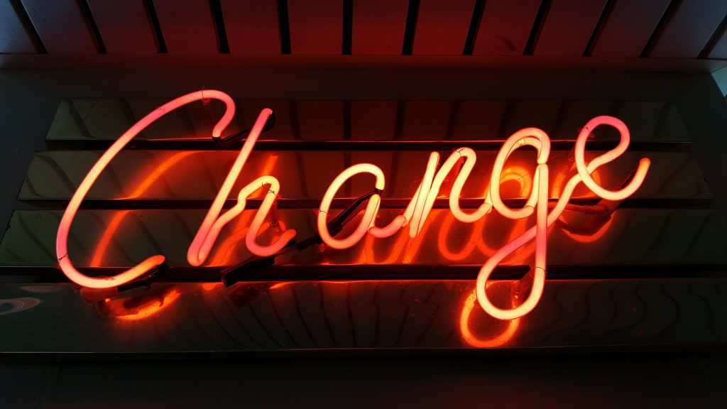 Neon Change sign.  Can we embrace change to reduce our carbon footprint?