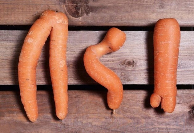 "Three ""ugly"" carrots.  Eating imperfect produce helps fight climate change."